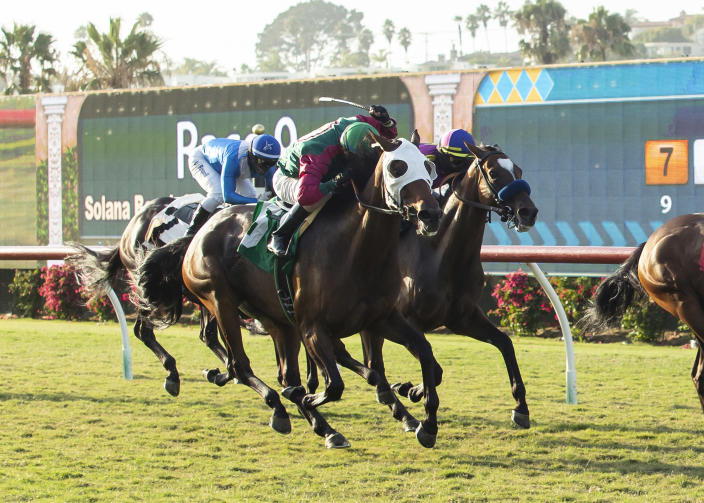 In a photo provided by Benoit Photo, Pulpit Rider and jockey Juan Hernandez, outside, overpower Cordiality, left, with Umberto Rispoli, and Mucho Unusual, right, with Flavien Prat, to win the $125,000 Solana Beach Stakes horse race Saturday, Aug. 15, 2020, at Del Mar Thoroughbred Club in Del Mar, Calif. (Benoit Photo via AP)