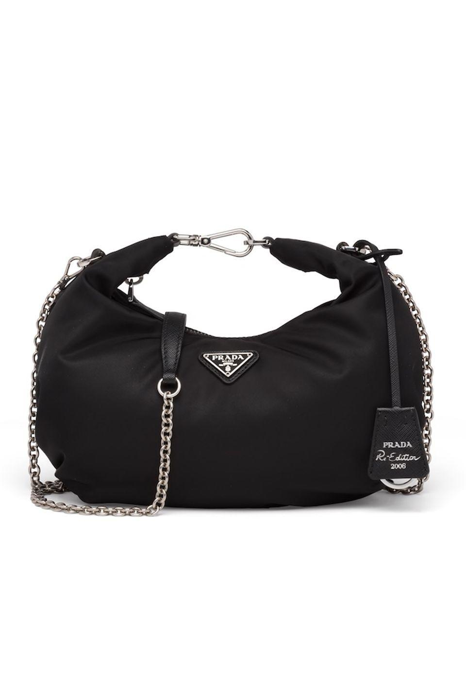 "<p>Prada's iconic nylon bags, first introduced in the '90s, have made an undeniable comeback, and we don't see their technical fabric losing popularity any time soon. The brand has been reissuing classic styles—like this <a href=""https://www.prada.com/us/en/products.re-edition_2000_nylon_mini_bag.1NE515_2DH0_F0638.html"" rel=""nofollow noopener"" target=""_blank"" data-ylk=""slk:2000 shoulder tote"" class=""link rapid-noclick-resp"">2000 shoulder tote </a>you've seen all over Instagram—but the latest is our favorite to date. The update has a removable chainlink strap that can be worn both across the shoulder, or be handheld from the tough, top-handle clasp. </p><p><em>Prada, $1,100; prada.com</em></p><p><a class=""link rapid-noclick-resp"" href=""https://www.prada.com/us/en/women/bags/shoulder_bags/products.prada_re-edition_2006_nylon_bag.1BH172_064_F0002_V_OOO.html"" rel=""nofollow noopener"" target=""_blank"" data-ylk=""slk:SHOP NOW"">SHOP NOW</a></p>"
