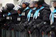 Riot police stand guard in front of German Embassy in Bangkok
