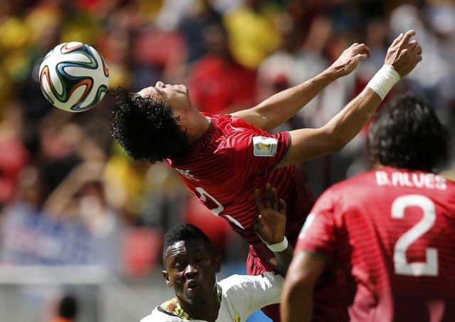 Portugal's Pepe (top) jumps for the ball against Ghana's Abdul Majeed Waris during their 2014 World Cup Group G soccer match at the Brasilia national stadium in Brasilia June 26, 2014. REUTERS/Ueslei Marcelino (BRAZIL - Tags: SOCCER SPORT WORLD CUP)