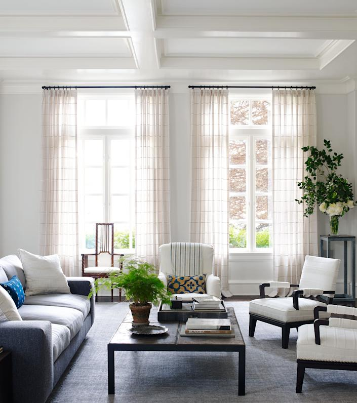Hagan outfitted her Connecticut home with her new line for The Shade Store; in the family room, drapery in Sankaty  Stripe.