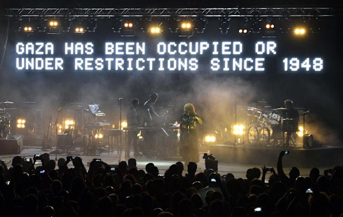 A Press Photo Agency picture shows British band Massive Attack performing in Lebanon on July 29, 2014, showing a message denouncing Israel's action against Gaza (AFP Photo/)