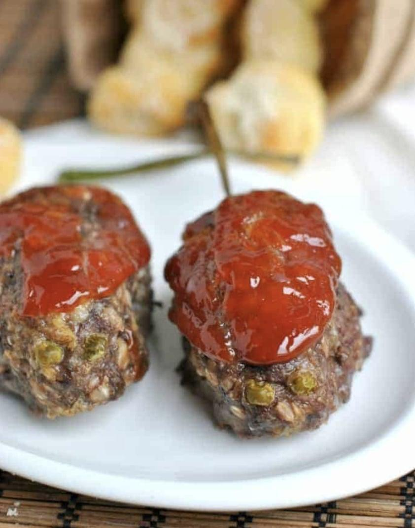 "<p>Yum, meatloaf with a <a class=""link rapid-noclick-resp"" href=""https://www.popsugar.co.uk/Halloween"" rel=""nofollow noopener"" target=""_blank"" data-ylk=""slk:Halloween"">Halloween</a> spin! No one will ever say meatloaf is boring again after they see this decked-out display. To make your presentation worthy of witches, add two peas in the front of the meatloaf to serve as the eyes and a stringy onion in the back to be the tail. Then add the blood!</p> <p><strong>Get the recipe:</strong> <a href=""https://www.shugarysweets.com/bloody-rats-meatloaf/"" class=""link rapid-noclick-resp"" rel=""nofollow noopener"" target=""_blank"" data-ylk=""slk:bloody rats meatloaf"">bloody rats meatloaf</a></p>"