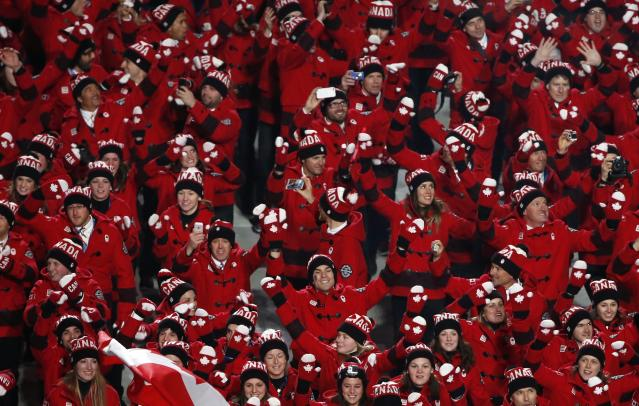 Canada's athletes march during the athletes' parade during the opening ceremony of the 2014 Sochi Winter Olympics, February 7, 2014. REUTERS/Lucy Nicholson (RUSSIA - Tags: OLYMPICS SPORT)
