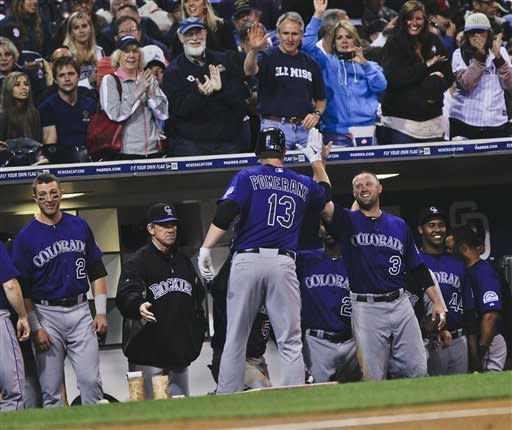 Colorado Rockies' Drew Pomeranz is greeted by Michael Cuddyer and other teammates after blasting a solo home run against the San Diego Padres during the third inning of a baseball game Monday, May 7, 2012 in San Diego. (AP Photo/Lenny Ignelzi)