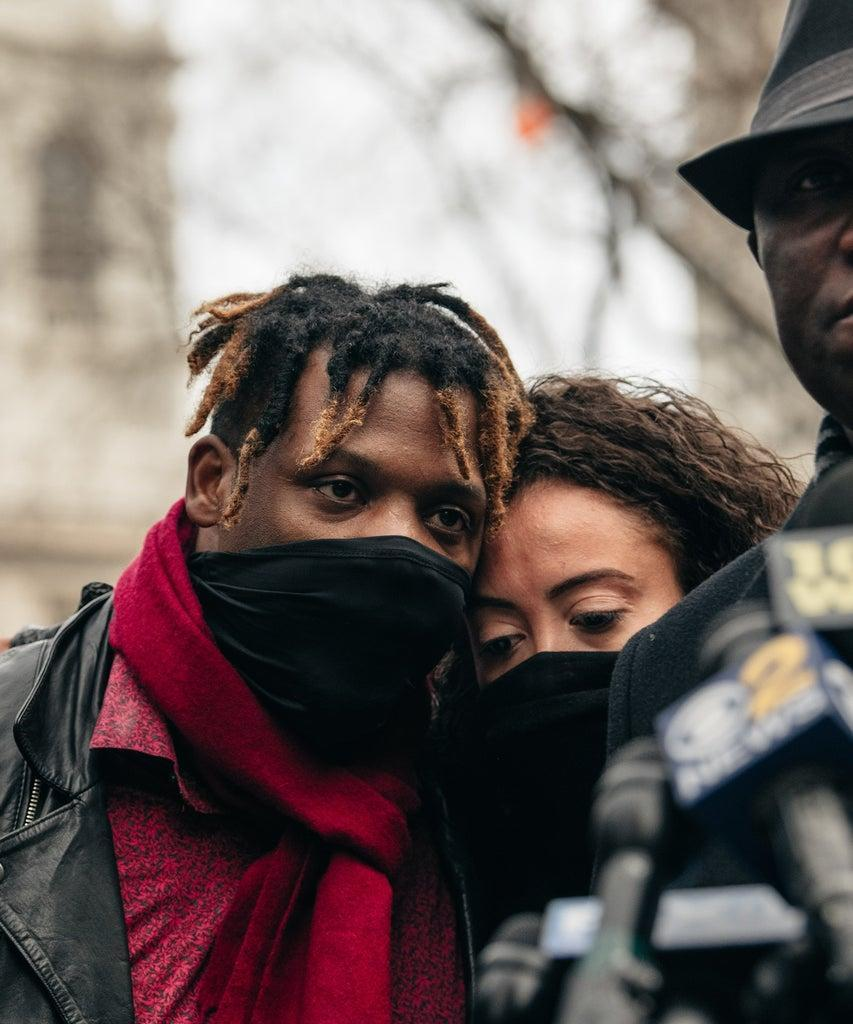 NEW YORK, NY – DECEMBER 30: Keyon, center left, and Kat Harrold, center right, look on at a press conference held in lower Manhattan on December 30, 2020 in New York City. After Harrold shared video footage of a white woman assaulting his son and wrongfully accusing the boy of stealing her phone in a Manhattan hotel lobby, civil rights leaders have called for an end to persistent racial profiling and injustice. (Photo by Scott Heins/Getty Images)