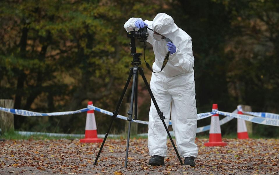 Forensics investigating at the scene in Watlington Hill  - Steve Parsons/PA