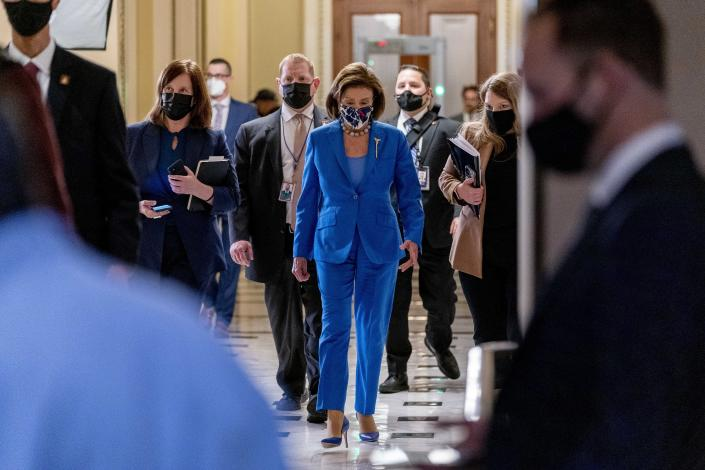 House Speaker Nancy Pelosi of Calif., back to her office after convening the House for legislative business at the Capitol in Washington, Tuesday, Oct. 12, 2021. The House is expected to vote to increase the debt limit later this afternoon. (AP Photo/Andrew Harnik)
