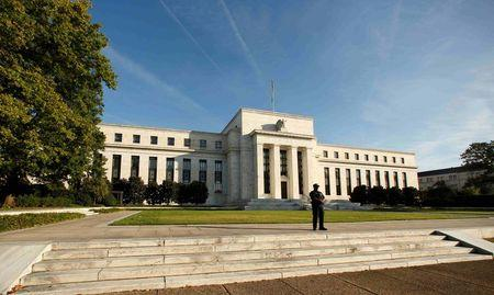 A police officer keeps watch in front of the U.S. Federal Reserve in Washington