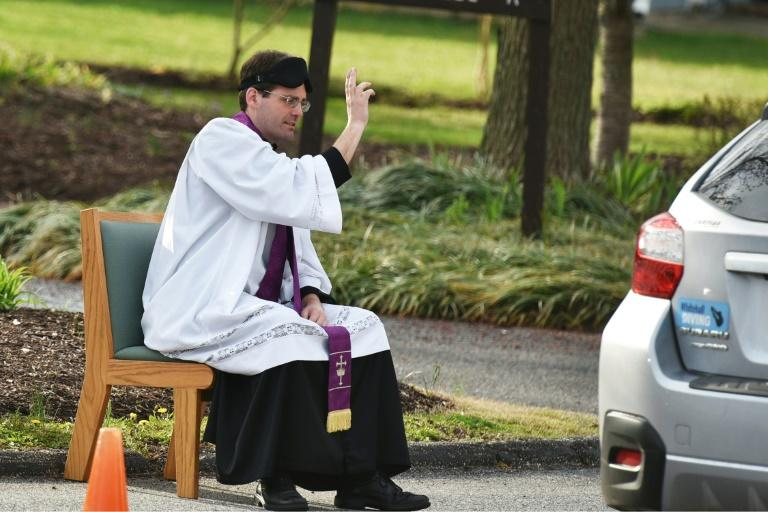 Father Scott Holmer holds drive-through confessionals in Maryland, with his church closed due to the coronavirus