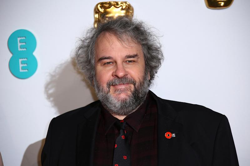 Director Peter Jackson poses for photographers upon arrival at the BAFTA awards in London, Sunday, Feb. 10, 2019. (Photo by Joel C Ryan/Invision/AP)