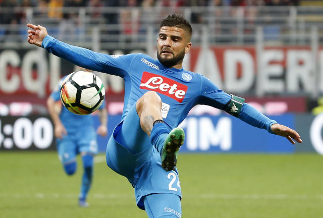 Napoli's Lorenzo Insigne stops the ball during the Serie A soccer match between AC Milan and Napoli at the San Siro stadium in Milan, Italy, Sunday, April 15, 2018. (AP Photo/Antonio Calanni)