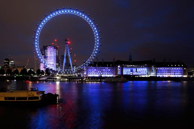 <p>The London Eye is illuminated in blue, representing the Conservative Party, after the first exit polls announced in Britain's general election, in London, Thursday, June 8, 2017. (Photo: Markus Schreiber/AP) </p>