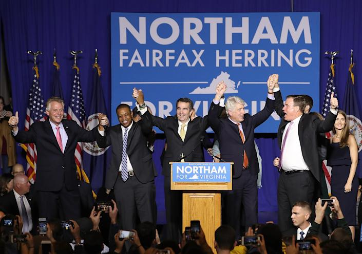 "<span class=""s1"">Gov.-elect Ralph Northam, center, links arms with current Gov. Terry McAuliffe, Lt. Gov.-elect Justin Fairfax, Attorney General Mark Herring and U.S. Sen. Mark Warner at an election night rally. (Photo: Win McNamee/Getty Images)</span>"