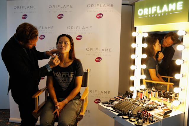 ISTANBUL, TURKEY - OCTOBER 20: Li Na of China attends the Oriflame Style Suite and has her make-up done during the previews of the TEB BNP Paribas WTA Championships at the Renaissance Polat Istanbul Hotel on October 20, 2013 in Istanbul, Turkey. (Photo by Dean Mouhtaropoulos/Getty Images)
