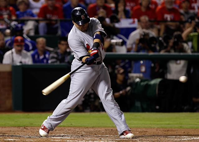 ARLINGTON, TX - OCTOBER 24: Yadier Molina #4 of the St. Louis Cardinals hits an RBI single in the second inning during Game Five of the MLB World Series against the Texas Rangers at Rangers Ballpark in Arlington on October 24, 2011 in Arlington, Texas. (Photo by Rob Carr/Getty Images)