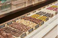 """<p><a href=""""https://www.harrods.com/en-gb/departments/harrods-food-halls/chocolate-hall"""" rel=""""nofollow noopener"""" target=""""_blank"""" data-ylk=""""slk:Harrods"""" class=""""link rapid-noclick-resp"""">Harrods</a> just opened up shop again with a brand-new chocolate hall. Choose from Harrods own chocolates (bonbons, chocolate-dipped confit fruit and filled bars), Pierre Marcolini, William Curley, To'ak, Patchi and more feature in the cavernous hall of treats. The major bonus is that if you visit, you can even see the Harrods chefs make the glorious confections for yourself.</p>"""
