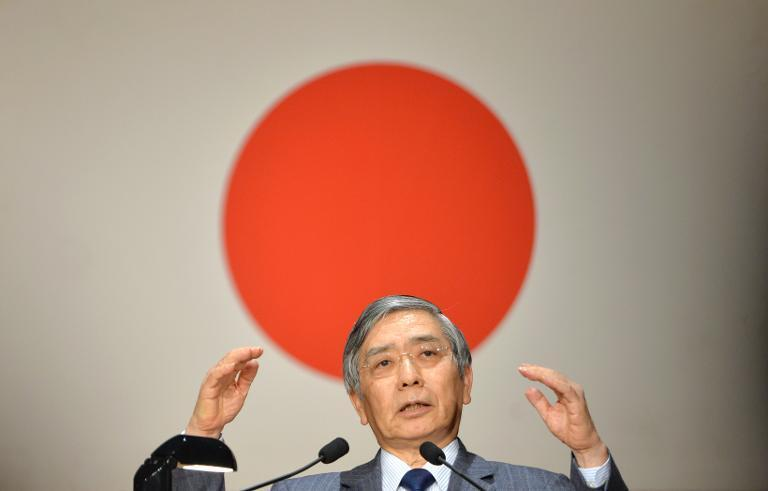 Bank of Japan says the economy is recovering, shown here is BoJ Governor Haruhiko Kuroda speaking in Tokyo on March 20, 2014