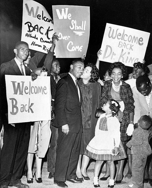 <p>Dr. Martin Luther King is given a welcome home kiss by his wife Coretta, upon his return to Atlanta following his release from Reidsville State Prison on bond, on Oct. 27, 1960. King's children, Yolanda, 5, and Martin Luther III, 3, join the welcome celebration. (AP Photo) </p>