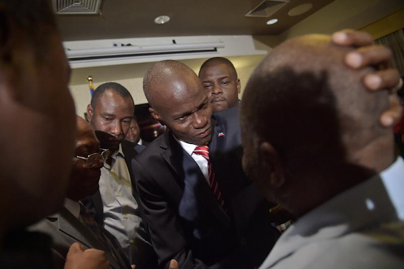Haiti's elected President Jovenel Moise (C) made an appeal for national unity in a speech after he was declared the winner of the November 20 elections on January 3, 2016