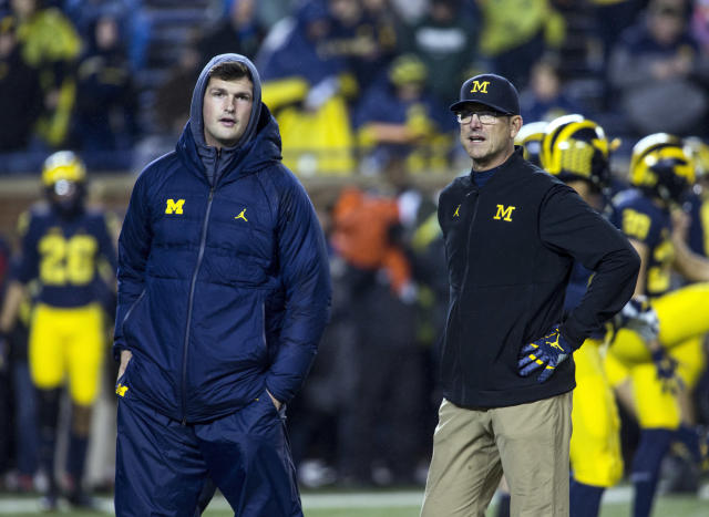 "Michigan quarterback <a class=""link rapid-noclick-resp"" href=""/ncaaf/players/239136/"" data-ylk=""slk:Wilton Speight"">Wilton Speight</a>, left, talks with head coach Jim Harbaugh, right, on the field during warmups before an NCAA college football game against Minnesota in Ann Arbor, Mich., Saturday, Nov. 4, 2017. (AP Photo/Tony Ding)"