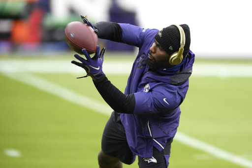 Baltimore Ravens wide receiver Dez Bryant works out prior to an NFL football game against the Tennessee Titans, Sunday, Nov. 22, 2020, in Baltimore. (AP Photo/Nick Wass)