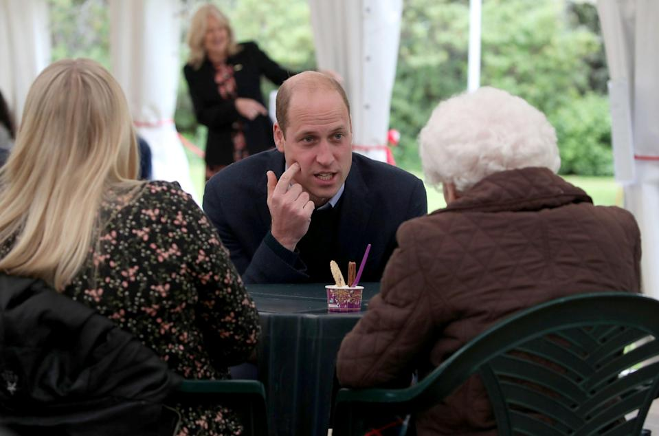 <p>Prince William, Duke of Cambridge chats to resident Betty Magee (96) and her granddaughter Kimberley Anderson during a visit to the Queens Bay Lodge Care Home in Edinburgh, Scotland.</p> (Getty)