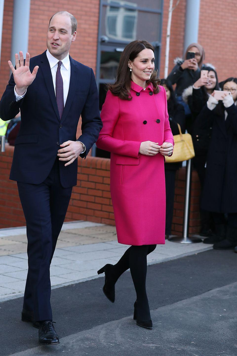 <p>Duckess Kate and Prince William paid a visit to Coventry, England. The Duchess wore a hot pink coat by Mulberry with a black clutch by the same brand with Tod's heels. </p>