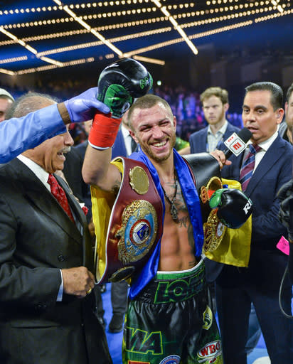 Vasiliy Lomachenko smiles after defeating Jose Pedraza in a WBO title lightweight boxing match at Madison Square Garden, Saturday, Dec. 8, 2018, in New York. (AP Photo/Howard Simmons)