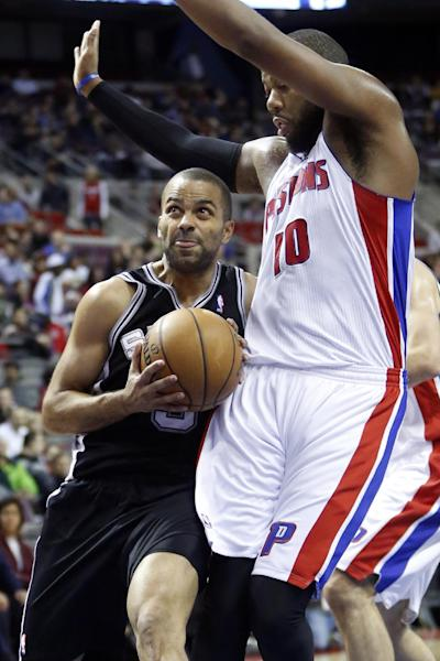 San Antonio Spur guard Tony Parker,left, goes to the basket against Detroit Pistons center Greg Monroe (10) in the first half of an NBA basketball game Friday, Feb. 8, 2013, in Auburn Hills, Mich. (AP Photo/Duane Burleson)