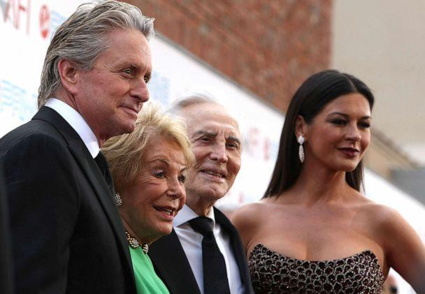 PHOTO: Actor Michael Douglas, Anne Buydens, actor Kirk Douglas and actress Catherine Zeta-Jones arrive at AFI Lifetime Achievement Award on June 11, 2009 in Culver City, Calif. (Kristian Dowling/Getty Images, FILE)