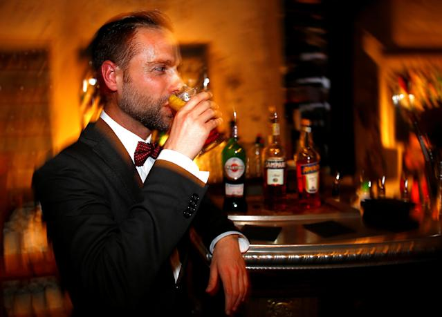 """A man drinks a cocktail made with Martini at the """"Spirit de Milan"""" in Milan, Italy, May 19, 2018. Picture taken May 19, 2018. REUTERS/Stefano Rellandini"""
