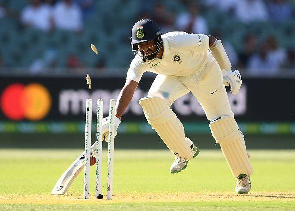 Cheteshwar Pujara getting run out on Day 1 of the 1st Test between Australia and India