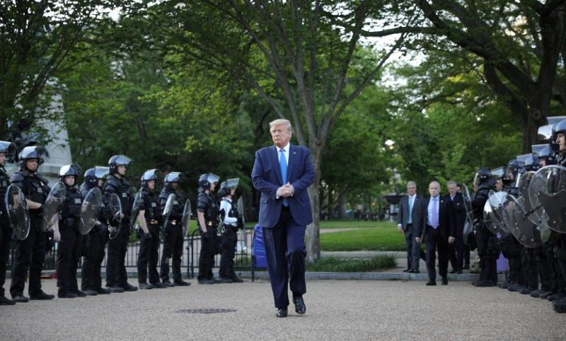 U.S. President Trump walks between lines of riot police in Washington
