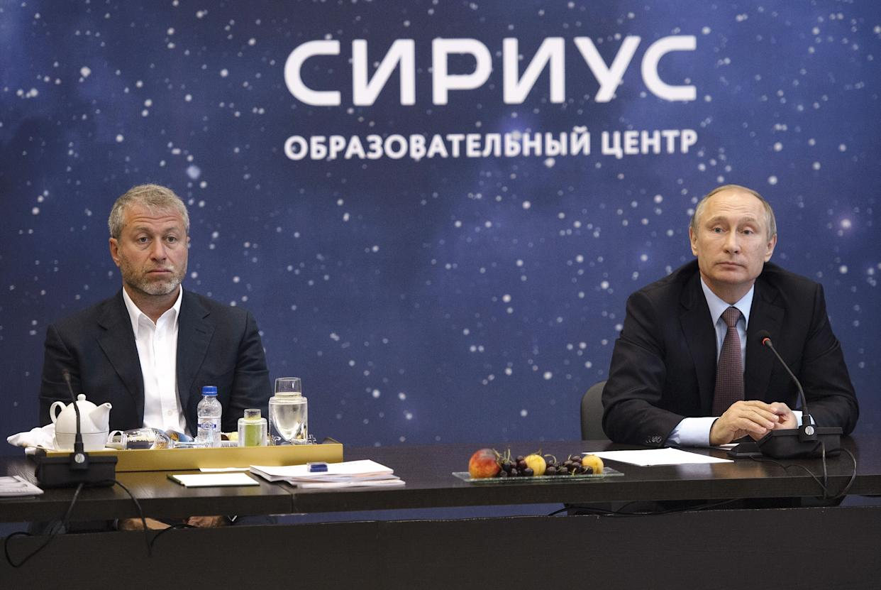 Roman Abramovich (left) and Russian President Vladimir Putin during a meeting in Sochi in 2016. (AP)