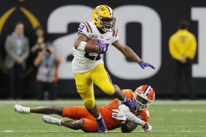 LSU running back Clyde Edwards-Helaire breaks away from Clemson cornerback Derion Kendrick during the second half of a NCAA College Football Playoff national championship game Monday, Jan. 13, 2020, in New Orleans. (AP Photo/Gerald Herbert)