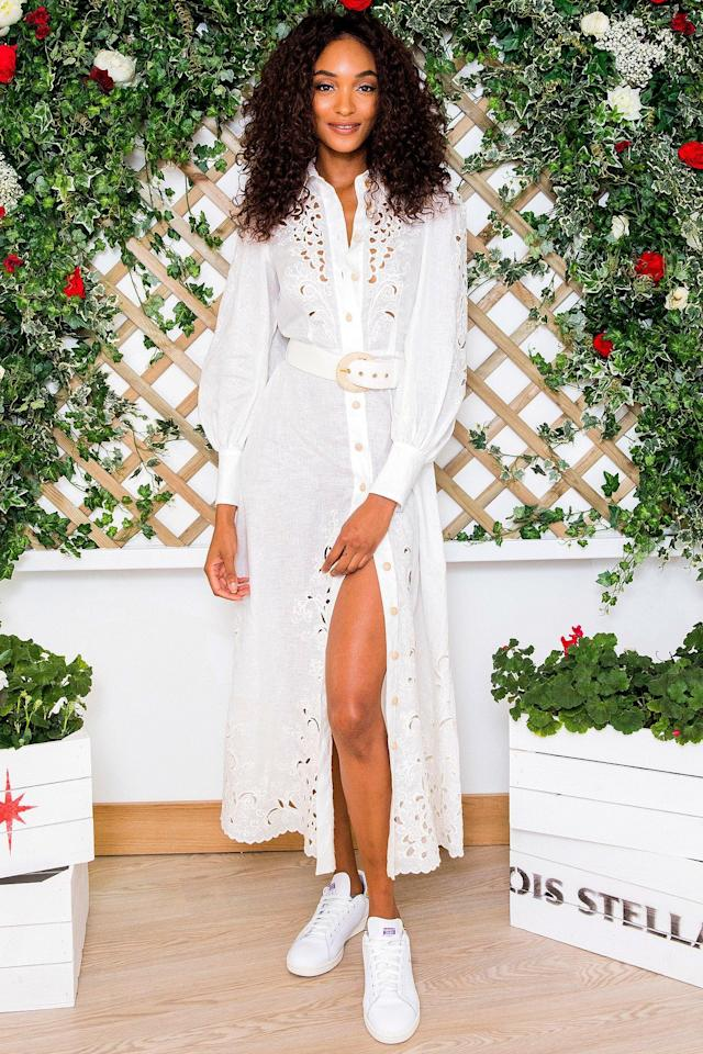 wears an embroidered Zimmermann shirtdress with a white belt and white sneakers at the Wimbledon Tennis Championships with Stella Artois in London.