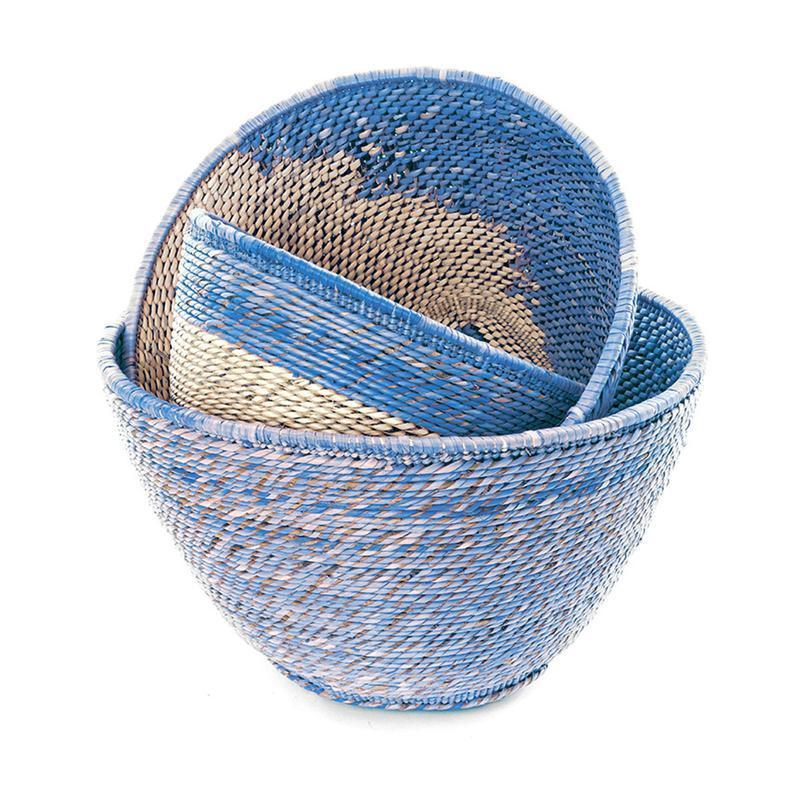 """Woven baskets without lids are also tried and tested bins for everything from blankets to loose change. Unsurprisingly, they're also home office-friendly. For loose items that you constantly need access to, Dabito suggests keeping them in these open options. """"I like woven baskets because they still look decorative on display in bookcases or shelves,"""" he says. Keep them within reach on floating shelves or on the floor adjacent to your desk. $109, Jungalow. <a href=""""https://www.jungalow.com/products/blue-nesting-basket-set"""" rel=""""nofollow noopener"""" target=""""_blank"""" data-ylk=""""slk:Get it now!"""" class=""""link rapid-noclick-resp"""">Get it now!</a>"""