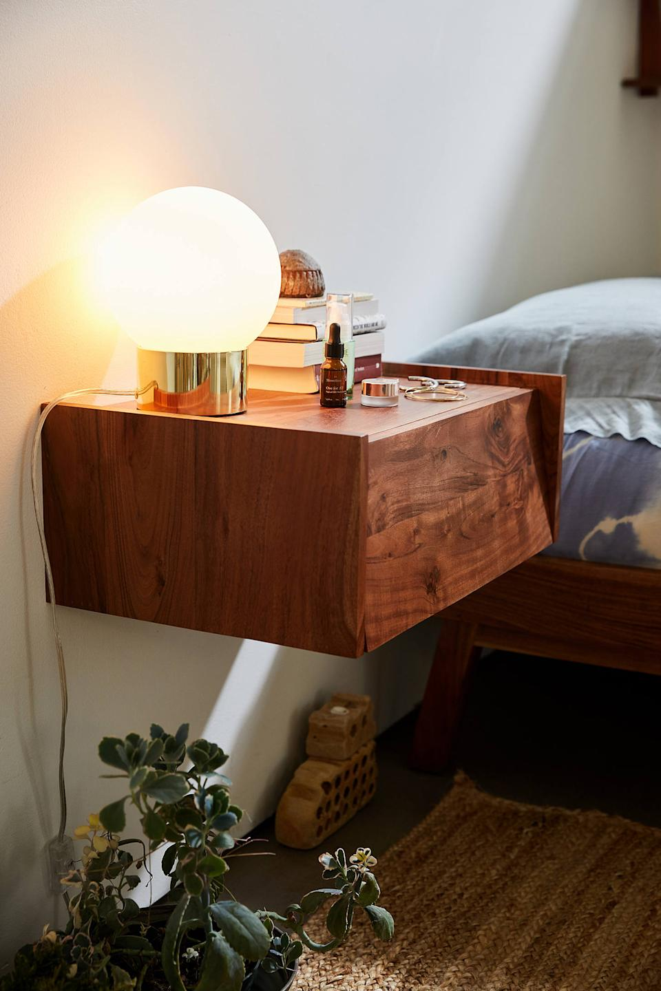 "For your bedroom, a modern floating nightstand can double as an office desk.<br><br><strong><em><a href=""https://www.urbanoutfitters.com/furniture"" rel=""nofollow noopener"" target=""_blank"" data-ylk=""slk:Shop Urban Outfitters"" class=""link rapid-noclick-resp"">Shop Urban Outfitters</a></em></strong><br><br><strong>Urban Outfitters</strong> Akina Floating Nightstand, $, available at <a href=""https://go.skimresources.com/?id=30283X879131&url=https%3A%2F%2Fwww.urbanoutfitters.com%2Fshop%2Fakina-floating-nightstand%3F"" rel=""nofollow noopener"" target=""_blank"" data-ylk=""slk:Urban Outfitters"" class=""link rapid-noclick-resp"">Urban Outfitters</a>"