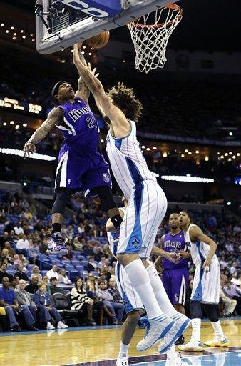 Sacramento Kings point guard Isaiah Thomas (22) goes to the basket against New Orleans Hornets center Robin Lopez during the first half of an NBA basketball game in New Orleans, Sunday, Feb. 24, 2013. Thomas was called for an offensive foul on the play. (AP Photo/Gerald Herbert)