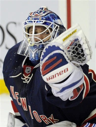 New York Rangers goaltender Henrik Lundqvist, of Sweden, makes a save during the first period of an NHL hockey game against the Washington Capitals Sunday, March 24, 2013, at Madison Square Garden in New York. (AP Photo/Bill Kostroun)