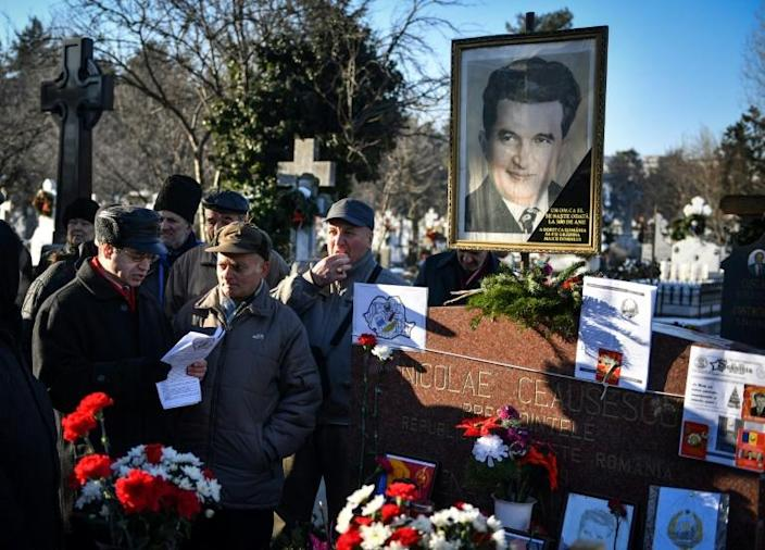 Rising nostalgia for the communist era prompted some Romanians to visit the graves of dictator Nicolae Ceausescu and his wife Elena in January 2018 to mark the 100th anniversary of Ceausescu's birth (AFP Photo/Daniel MIHAILESCU)