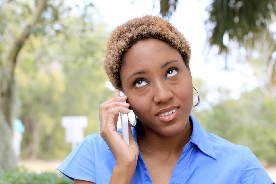 Woman rolling eyes while on the phone