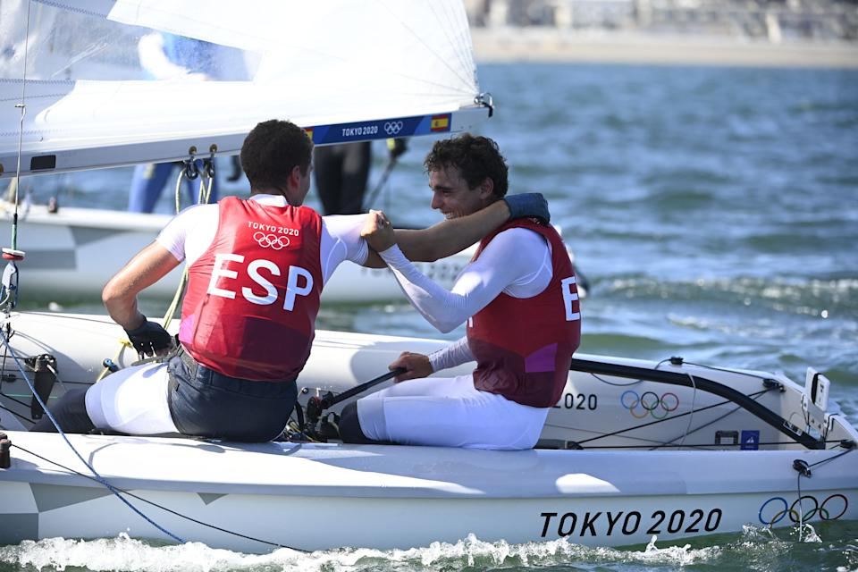 Spain's Spain's Jordi Xammar and Spain's Nicolas Rodriguez Garcia-Paz celebrate after the men's two-person dinghy 470 medal race during the Tokyo 2020 Olympic Games sailing competition at the Enoshima Yacht Harbour in Fujisawa, Kanagawa Prefecture, Japan, on August 4, 2021. (Photo by Olivier MORIN / AFP) (Photo by OLIVIER MORIN/AFP via Getty Images)