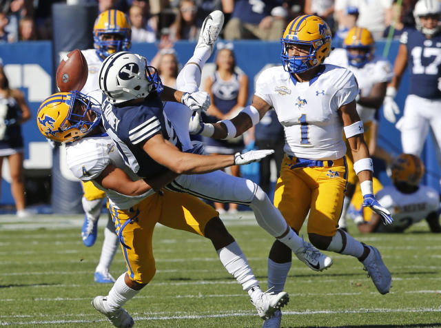 McNeese State's Darion Dunn (1) and Colby Burton (4) defend against BYU wide receiver Gunner Romney, center, in the first half during an NCAA college football game Saturday, Sept. 22, 2018, in Provo, Utah. (AP Photo/Rick Bowmer)