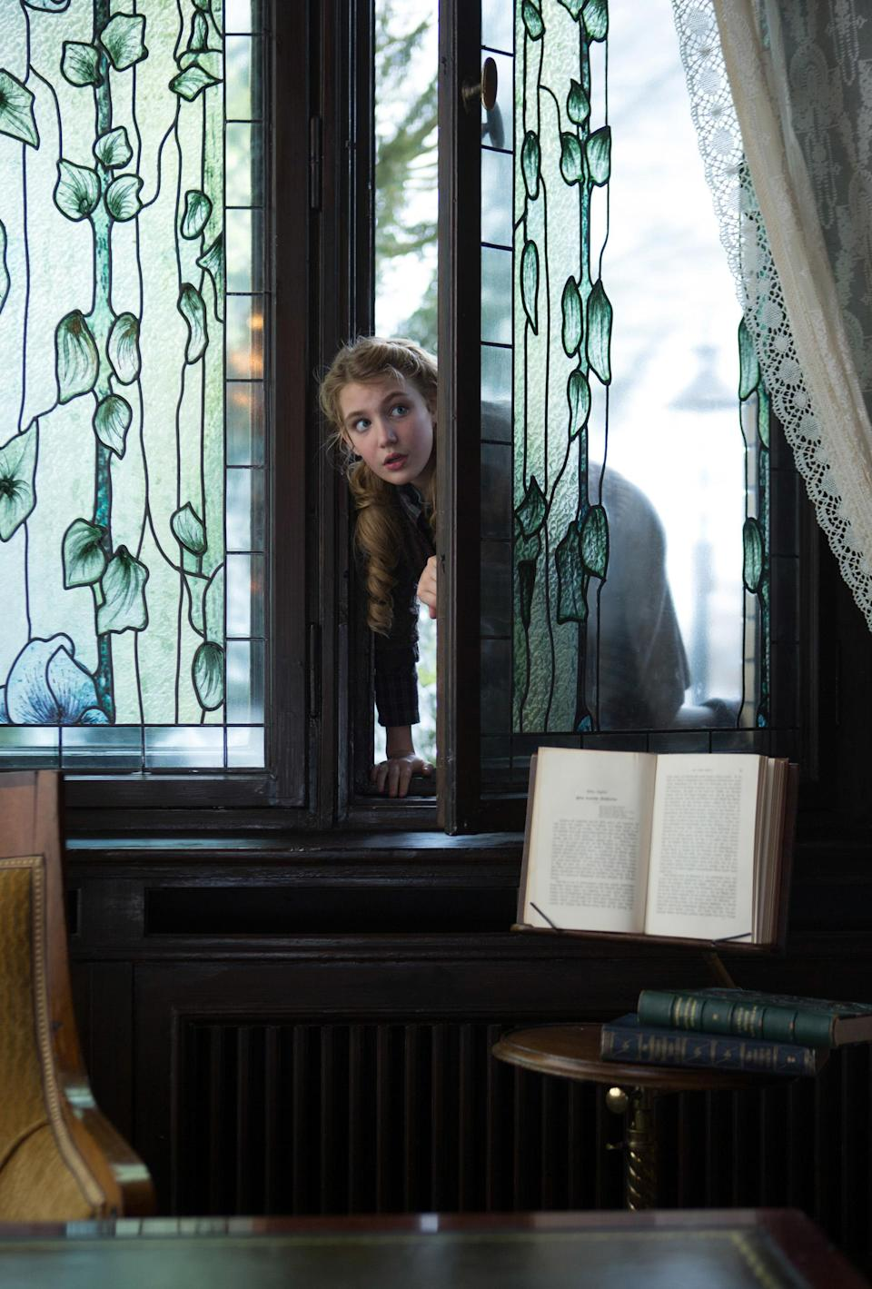 """This image released by 20th Century Fox shows Sophie Nélisse in a scene from """"The Book Thief,"""" about a girl who loves books. (AP Photo/20th Century Fox, Jules Heath)"""