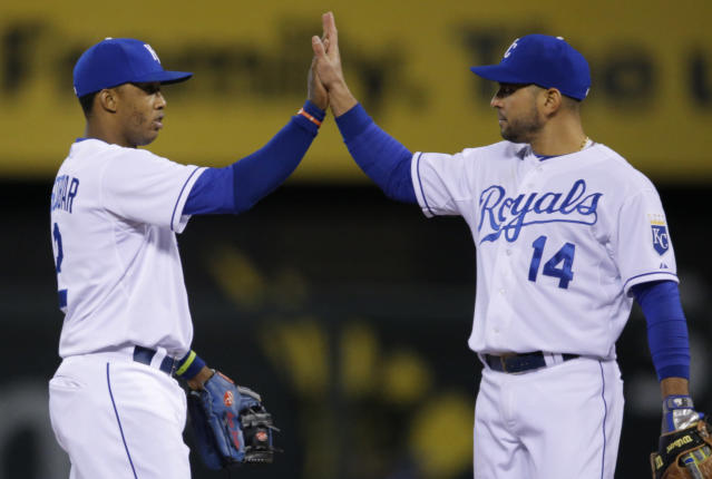Kansas City Royals shortstop Alcides Escobar, left, and second baseman Omar Infante (14) celebrate following a baseball game against the Toronto Blue Jays at Kauffman Stadium in Kansas City, Mo., Wednesday, April 30, 2014. The Royals defeated the Blue Jays 4-2. (AP Photo/Orlin Wagner)