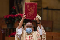 Father David Gallardo leads Christmas Eve Mass at Cathedral of Our Lady of the Angels, Thursday, Dec 24, 2020, in Los Angeles. California became the first state to record 2 million confirmed coronavirus cases, reaching the milestone on Christmas Eve as nearly the entire state was under a strict stay-at-home order and hospitals were flooded with the largest crush of cases since the pandemic began. (AP Photo/Ashley Landis)