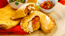 """<p>This savory seasonal empanada recipe is great as a dinner or an appetizer to <a href=""""https://www.thedailymeal.com/entertain/25-best-party-foods-recipes-slideshow?referrer=yahoo&category=beauty_food&include_utm=1&utm_medium=referral&utm_source=yahoo&utm_campaign=feed"""" rel=""""nofollow noopener"""" target=""""_blank"""" data-ylk=""""slk:bring to a party"""" class=""""link rapid-noclick-resp"""">bring to a party</a>.</p> <p><a href=""""https://www.thedailymeal.com/recipes/pumpkin-empanadas-recipe-0?referrer=yahoo&category=beauty_food&include_utm=1&utm_medium=referral&utm_source=yahoo&utm_campaign=feed"""" rel=""""nofollow noopener"""" target=""""_blank"""" data-ylk=""""slk:For the Pumpkin Empanadas recipe, click here."""" class=""""link rapid-noclick-resp"""">For the Pumpkin Empanadas recipe, click here.</a></p>"""
