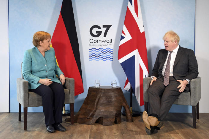 Britain's Prime Minister Boris Johnson, right, and German Chancellor Angela Merkel ahead of a bilateral meeting during the G7 summit in Cornwall, England, Saturday June 12, 2021. (Stefan Rousseau/Pool via AP)
